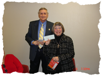 Marshall Regional Arts Council President presents check to Waskom Library for Playaways
