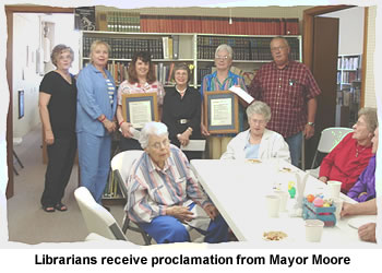 Librarians receive proclamation from Mayor Moore